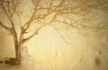 Buddha meditating under a tree