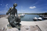 Njivice fisherman's statue