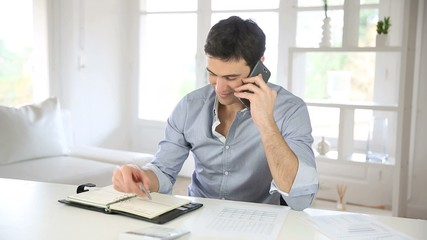 Home-office worker using smartphone