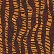 African  seamless patters with tiger skin and  tribal symbols