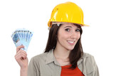 Young handy woman holding wage poster