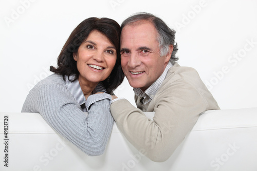 happy mature couple sitting on the couch