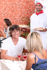 Young couple on a date in a pizzeria.