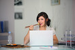 Woman eating in front of computer
