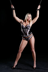 bondage style with a beautiful woman in sexy lingerie cuffed