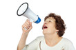 Elderly woman shouts something into a megaphone