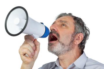An elderly man shouts into megaphone