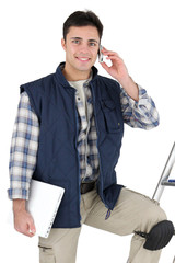 Tiler with mobile phone and equipment