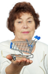 Elderly woman holds toy cart on her palm