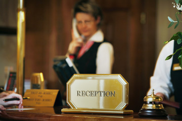 luxurious reception area with receptionist phoning