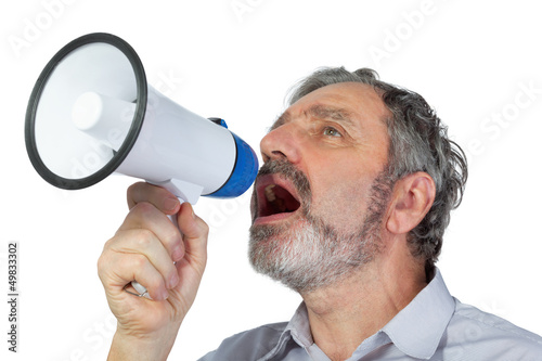 An elderly man shouts into megaphone