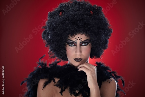 Young woman dressed like devil