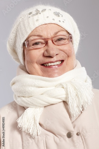 Closeup portrait of old lady at winter
