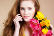 Beautiful redheared girl with tulips