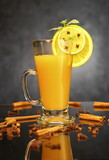 Hot orange juice in glass cup and spice