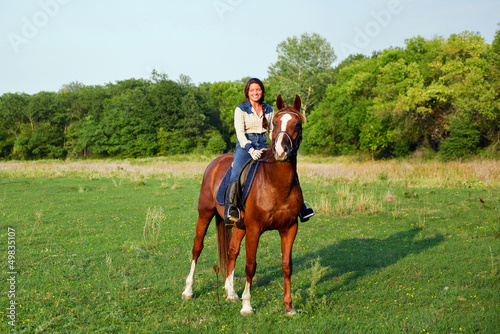 pretty young woman riding horse
