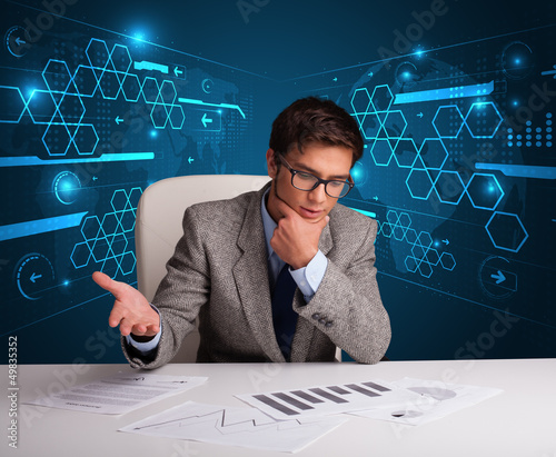 Businessman doing paperwork with futuristic background