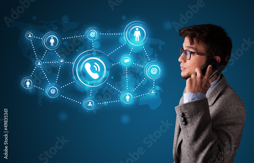 Young boy making phone call with social network icons