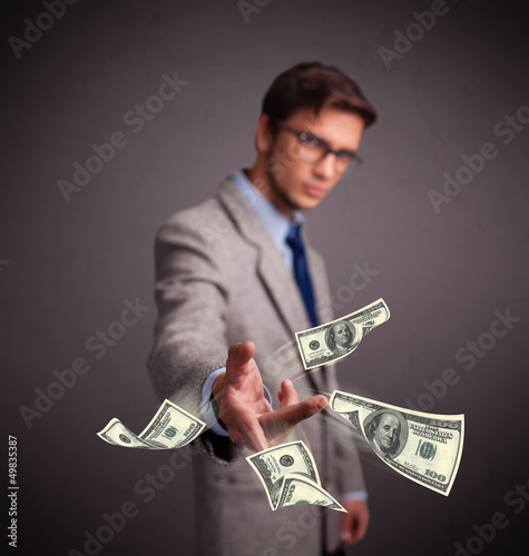 Young man throwing money