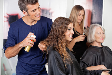 Hairdressers Setting Up Client's Hair