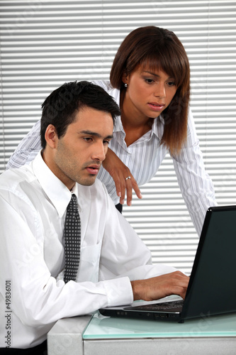 co-workers in front of laptop