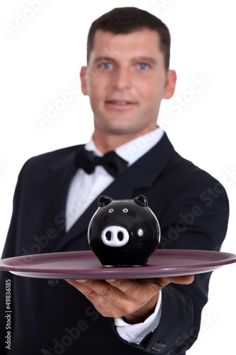 Waiter serving a piggy bank