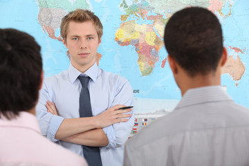 Businessman speaking in front map