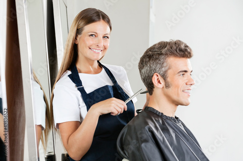 Hairstylist Giving Haircut To Customer