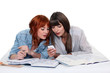 Two female students procrastinating.