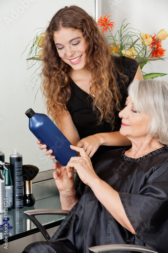 Hairdresser Advising Hair Color To Customer