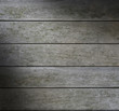 Grayish weathered horizontal wood lit diagonally