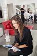 Woman Reading Magazine At Parlor