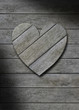 Gray weathered wood heart on wooden background
