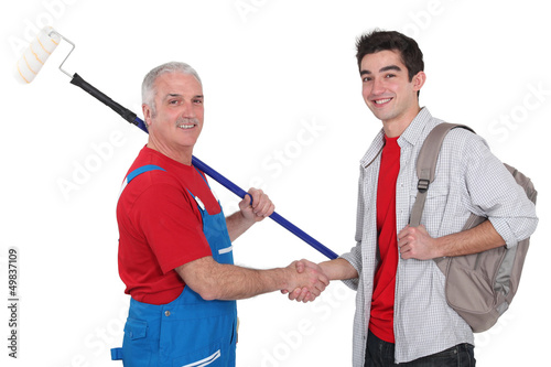 Painter and young man shaking hands