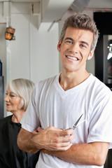 Hairstylist Holding Scissors In Salon