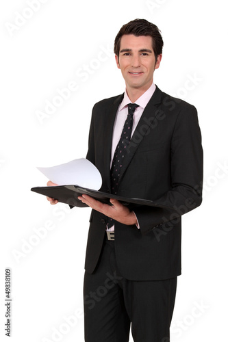Businessman reading notes from meeting