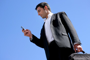 Consultant with mobile phone outdoors