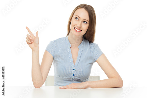 Smiling woman pointing up