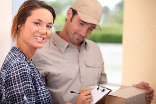 Woman signing for a package