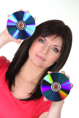 Woman holding CDs on white background