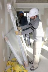 Worker installing new windows