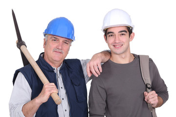 A mature construction worker and his grandson.