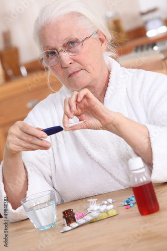 Old lady taking medication