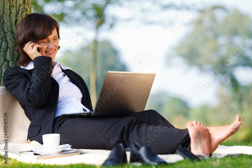 businesswoman working outdoor in park