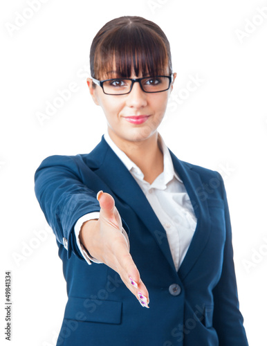 Happy business woman with an open hand ready to seal a deal