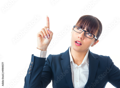 Attractive young businesswoman touching the glass