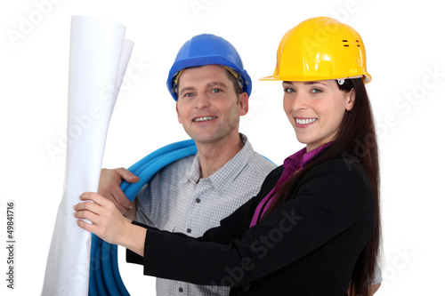 businesswoman and craftsman looking at a blueprint