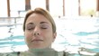 Woman relaxing in spa center pool