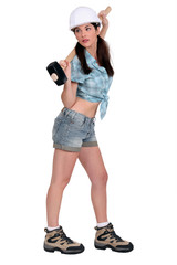 Attractive female builder with sledge-hammer
