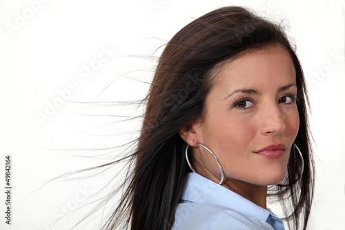 Brunette wearing hoop earrings